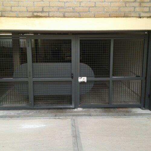 Cancello Automatico per Autorimessa Condominiale con cancelletto pedonale integrato, Roma - Cebi