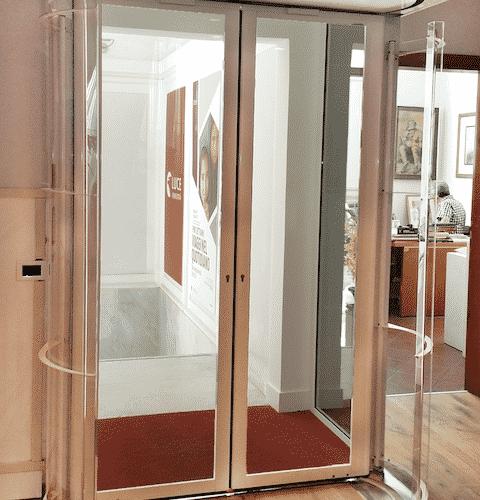 Porta automatica rototraslante FAAC Cebi, Roma