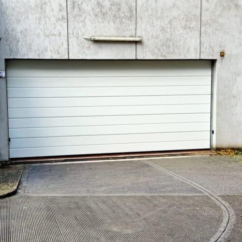Portone sezionale automatico per garage condominiale, Roma - Fornitura e Installazione CEBI Srl